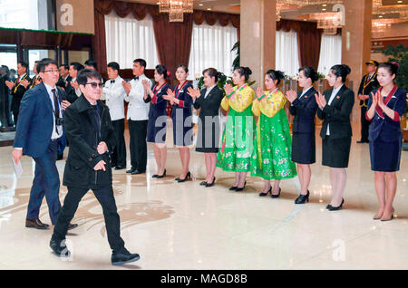 Cho Yong-pil, Mar 31, 2018 : South Korean singer Cho Yong-pil (front L) arrives at Koryo Hotel in Pyongyang, North Korea. South Korean taekwondo athletes and K-Pop musicians such as Cho Yong-pil, Lee Sun-hee, Choi Jin-hee, Yoon Do-hyun (YB), Baek Ji-young, Red Velvet, Jungin, Seohyun (Girls' Generation), Ali, Kang San-eh and Kim Kwang-min will perform at the East Pyongyang Grand Theater on Sunday and will perform in a joint concert with North Korean artists on Tuesday at the Ryugyong Jong Ju Yong Gymnasium in Pyongyang in a cross-border cultural exchange ahead of an inter-Korean summit schedul - Stock Photo