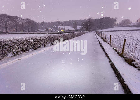 Flintshire, Wales, UK Weather: A washout Easter Bank Holiday ends with a Met Officer weather warning for rain and snow for Bank Holiday Monday. A snowy landscape at Pantasaph Friary on a very snowy morning in the village of Pantasaph, Flintshire on Easter Bank Holiday Monday - Stock Photo