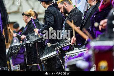 Bolney Sussex UK 2nd April 2018  - The Stix Drummers have rain bouncing off their drums at the annual Bolney Pram Race today which is held at the Eight Bells pub in the village every Easter Bank Holiday Monday raising money for local charities SERV Sussex and Age UK Photograph taken by Simon Dack Credit: Simon Dack/Alamy Live News - Stock Photo