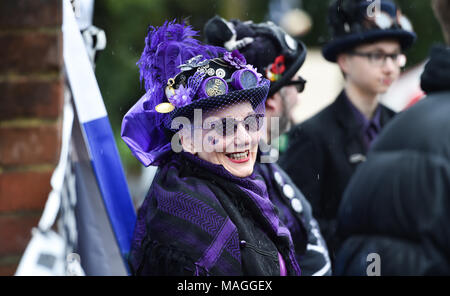 Bolney Sussex UK 2nd April 2018  - Members of Stix Drummers at the annual Bolney Pram Race in torrential rain today which is held at the Eight Bells pub in the village every Easter Bank Holiday Monday raising money for local charities SERV Sussex and Age UK Photograph taken by Simon Dack Credit: Simon Dack/Alamy Live News - Stock Photo