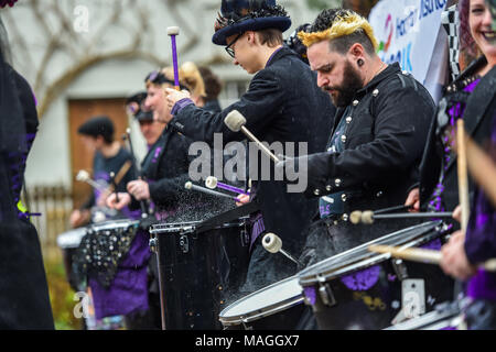 Bolney Sussex UK 2nd April 2018 - The Stix Drummers perform in the rain at the annual Bolney Pram Race today which is held at the Eight Bells pub in the village every Easter Bank Holiday Monday raising money for local charities SERV Sussex and Age UK Photograph taken by Simon Dack Credit: Simon Dack/Alamy Live News - Stock Photo