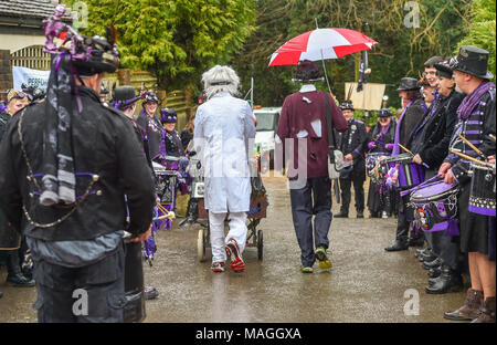 Bolney Sussex UK 2nd April 2018 - Competitors and spectators brave the rain at the annual Bolney Pram Race today which is held at the Eight Bells pub in the village every Easter Bank Holiday Monday raising money for local charities SERV Sussex and Age UK Photograph taken by Simon Dack Credit: Simon Dack/Alamy Live News - Stock Photo