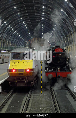 Royal Scot class 4-6-0 steam loco 46115 'Scots Guardsman' and East Coast Railways InterCity 225 at London King's Cross station, 9th November 2014. - Stock Photo