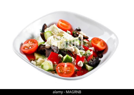 Greek salad. Vegetable with shitake mushrooms, green salad, with cherry tomatoes, fetta cheese, red onion, and mixed greens - Stock Photo