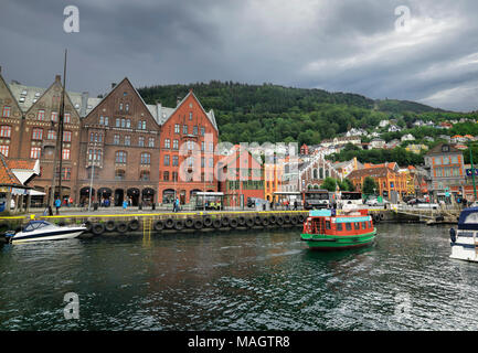 Cityscape with quay and street with old wooden houses in harbour of Bergen. Norway, Scandinavia - Stock Photo