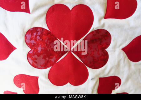 A quilt made out of four hearts. - Stock Photo