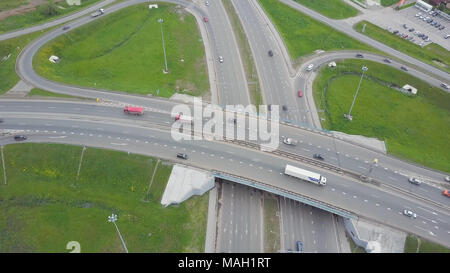 Aerial view of a freeway intersection. Clip. Highway and overpass with cars and trucks, interchange, two-level road junction in the big city. Top view. - Stock Photo