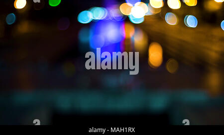 Out of focus background with blurry unfocused lights. Video. Color Blurred background : Bokeh lighting in city night light blur bokeh. Floodlights. Concert stage flash lights. - Stock Photo