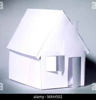 paper house with open door.isolated on grey - Stock Photo