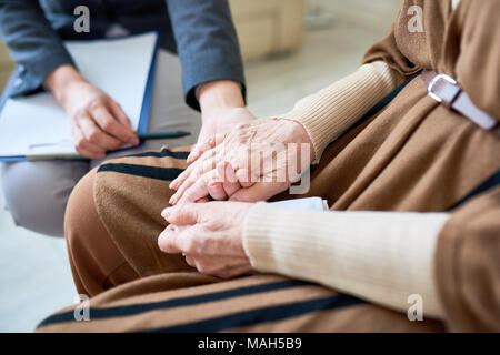 Psychologist Helping Senior Patient - Stock Photo
