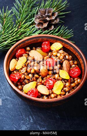 national Russian Christmas dish, a porridge with raisins and almonds, kutya - Stock Photo