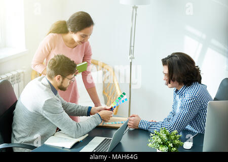 Creative colleagues choosing colors for design - Stock Photo