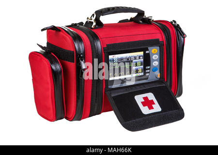 Modern portable biphasic defibrillator in red bag isolated on white - Stock Photo