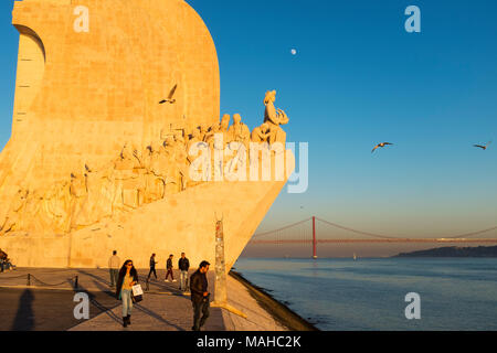 Lisbon, Portugal - January 10, 2017: People enjoying the sunset near the Monument to the Discoveries (Padrao dos Descobrimentos) in the city of Lisbon - Stock Photo