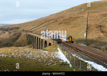 A Sprinter passenger train crosses Arten Gill Viaduct, Dentdale, Yorkshire Dales National Park, on the Settle-Carlisle railway line. - Stock Photo