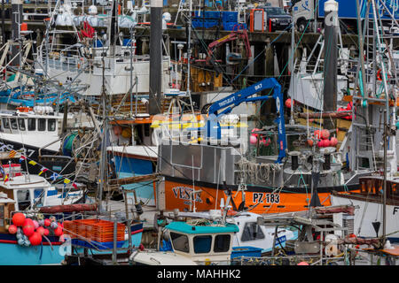 a large quantity of fishing boats and trawlers in the busy packed and cramped cornish fishing town of newlyn on the west cornsih coast. colourful port - Stock Photo