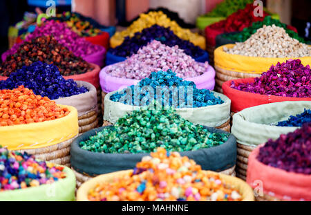 Multicolored dried flowers, used for soaps and perfumes as well as coloring, dyes and as an ingredient in foods, on sale in the souks of Marrakesh's m - Stock Photo