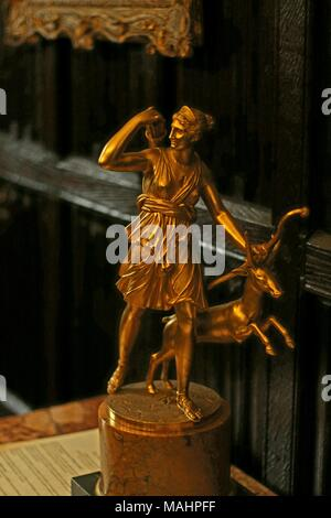 Graeco-Roman Art Figure - Diana goddess of the hunt, moon,and nature in Roman mythology equated with the Greek goddess Artemis, at Anglesey Abbey, UK - Stock Photo