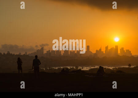 A dramatic sunset at Dudley Page Reserve, Eastern Suburbs, Sydney. Great views of the Sydney Skyline at sunset. - Stock Photo