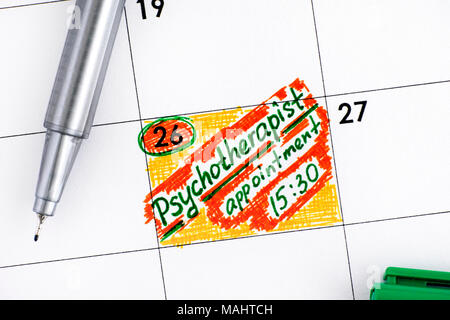 Reminder Psychotherapist Appointment in calendar with green pen. - Stock Photo
