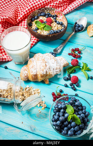Multigrain wholewheat healthy cereals with fresh berry for breakfast. - Stock Photo