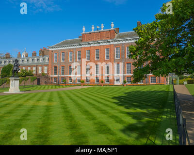 View of Kensington Palace, a royal residence situated in Kensington Gardens with a statue of King William III in London on a sunny day. - Stock Photo