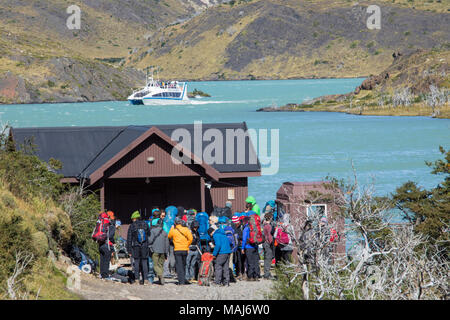 Hikers waiting for Hielos Patagonicos, Sightseeing boat on Lago Pehoe, Torres del Paine National Park, Patagonia, Chile - Stock Photo