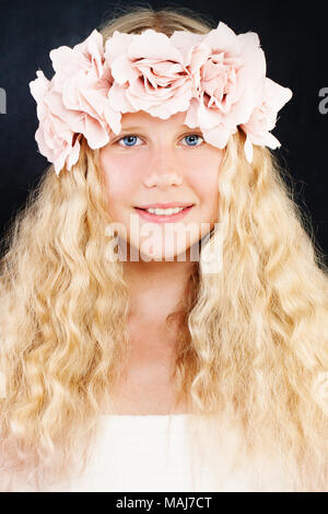 Young Beauty. Young Girl with Long Blonde Hair and Rose Flowers Wreath. Teen Girl - Stock Photo