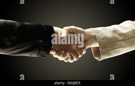 closeup.reliable handshake business partners.the concept of coo - Stock Photo