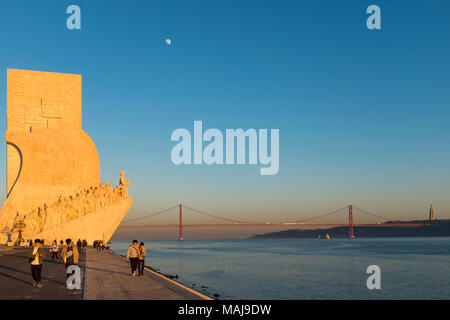 Lisbon, Portugal - January 10, 2017: Tourists enjoying the sunset near the Monument to the Discoveries (Padrao dos Descobrimentos) in the city of Lisb - Stock Photo