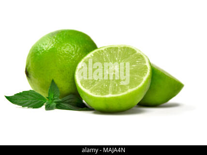 Fresh limes, isolated on white background. Cross section and whole lime fruits with mint leaf, citrus fruit background. - Stock Photo