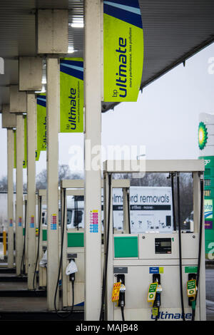 A petrol station within a motorway service station selling dieasel and petrol fuels - Stock Photo