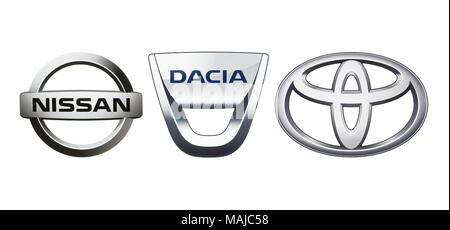 Kiev, Ukraine - November 09, 2017: Collection of popular car logos printed on white paper: Nissan, Dacia and Toyota - Stock Photo