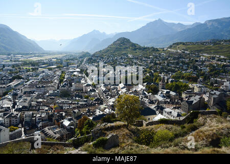 A view of the Swiss city of SIon, seen from the hilltop Basilique Notre Dame de Valère, in the upper Rhone Valley, canton of Valais, Switzerland. - Stock Photo