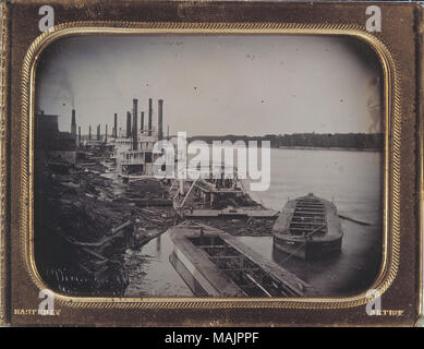 A view of the dry docks along the St. Louis River Front with the Mississippi River in the background. A boy with a small boats can be seen on the shore, and many large steamboats are docked. Some men can be seen on the ships, and also some architecture can be seen in the background off to the right. Inscribed in the bottom-left corner is 'View on the Mississippi River'. The frame around the daguerreotype has 'Easterly' engraved in its lower-left corner and 'Artist' engraved in the lower right. Title: Dry Docks, St. Louis River Front.  . between circa 1852 and circa 1853. Thomas M. Easterly - Stock Photo