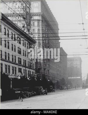 Vertical, black and white photograph looking north on Twelfth Street (later Tucker Boulevard) at Locust Street. The left side of the photograph shows the Shubert Theater in the Union Electric Building, as well as several neighboring buildings. Fir trees can be seen behind a row of parked cars in front of the theater. Power lines criss-cross the center of the image. For a detail taken from this image, see P0054-00002. A typed note on the back of the P0054-00002 print reads: 'North in Twelfth Blbd. at Locust street. Old Shubert Theatre was in the Union Electric Building, prior to addition of fiv - Stock Photo