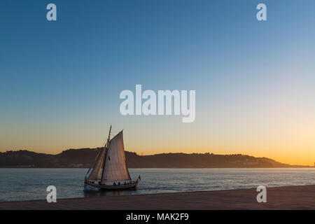 Lisbon, Portugal - January 10, 2017: Traditional sailboat cruising in the Tagus River in Lisbon, Portugal - Stock Photo