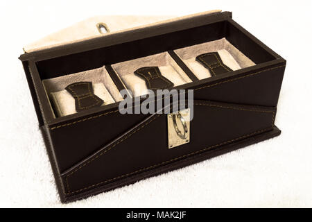 Luxury watch gift box. Personal, present. Empty and sewn watch box in leather fabric with lock - Stock Photo