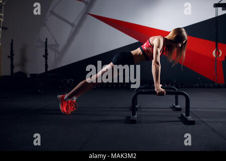 Photo of sports woman doing exercise bar - Stock Photo