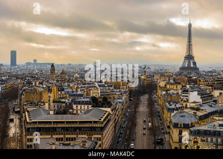 Eiffel Tower after a rainy day in the romantic city of Paris - Stock Photo