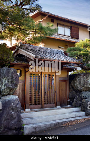 Modern Japanese private residential house with the front gate built in a traditional style. Uji, Kyoto prefecture, Japan 2017. - Stock Photo