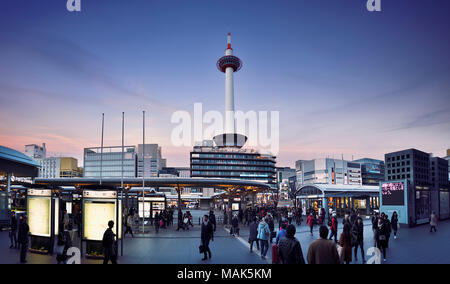 View on Kyoto tower from Kyoto Station busy with people in the evening, beautiful sunset city scenery in Shimogyo-ku, Kyoto, Japan 2017. - Stock Photo