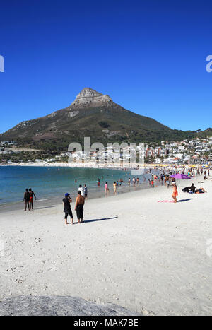The sandy, white beaches of upmarket Camps Bay, with the Lion's Head beyond, in Cape Town, South Africa - Stock Photo