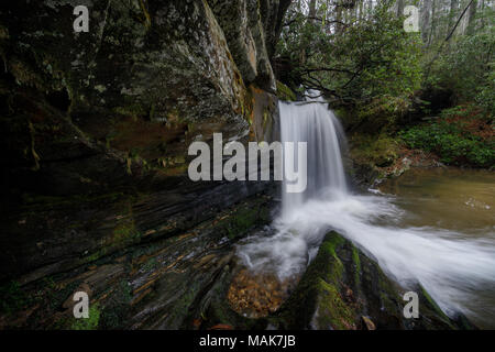 Raper Creek Falls is located in north Georgia in the county of Habersham.  The falls themselves are approximately 15 ft. high and unique in the aspect that the stream is running diagonal across a rock shelf before falling into the plunge pool below. - Stock Photo
