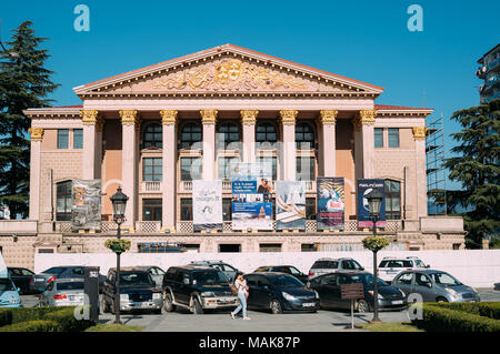Batumi, Adjara, Georgia - September 10, 2017: Young Woman Walking Near Batumi State Drama Theatre named after I. Chavchavadze - Stock Photo
