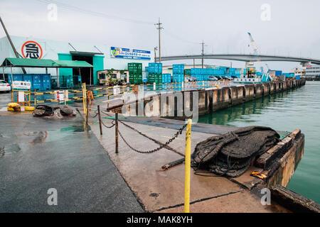 Okinawa, Japan - June 12, 2016 : Tomari port in rainy day