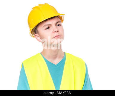 Teen boy in hard hat - Stock Photo