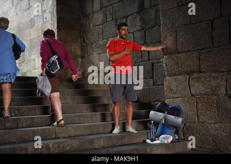 The moment of emotion as Pilgrims arrive in the Cathedral Square of Santiago de Compostela in northern Spain after walking the  Camino de Santiago - Stock Photo