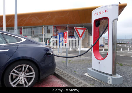 Tesla car charging point terminal at Eurotunnel Le Shuttle in France - Stock Photo