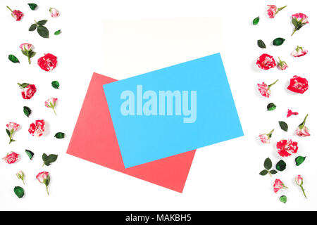 Frame made of rose flowers and empty blank colored paper sheets for text in the middle. - Stock Photo